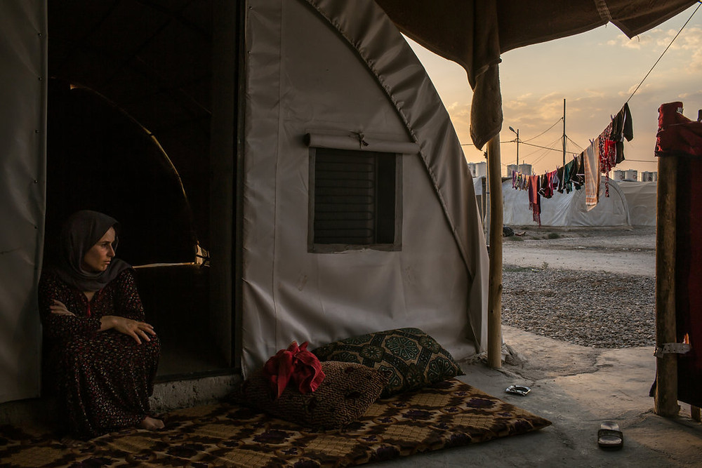 Image: Aishan Ali Saleh, 40, at a refugee camp on the outskirts of Dohuk. She had lived in Kojo, one of the southernmost villages on Mount Sinjar, which was overrun by Islamic State fighters. Credit Mauricio Lima for The New York Times