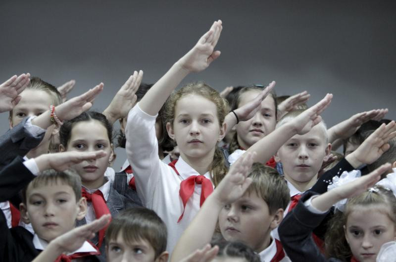 Children, wearing red neckerchiefs, a symbol of the Pioneer Organization, at a school in Stavropol region, Russia, November 2015.