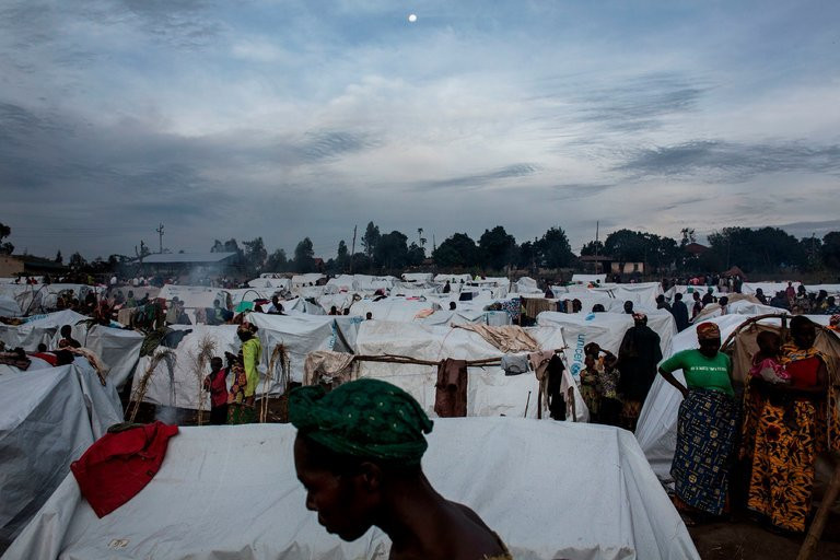 A refugee camp in Bunia, Democratic Republic of Congo. Millions have been affected by domestic conflict. Credit John Wessels/Agence France-Presse — Getty Images