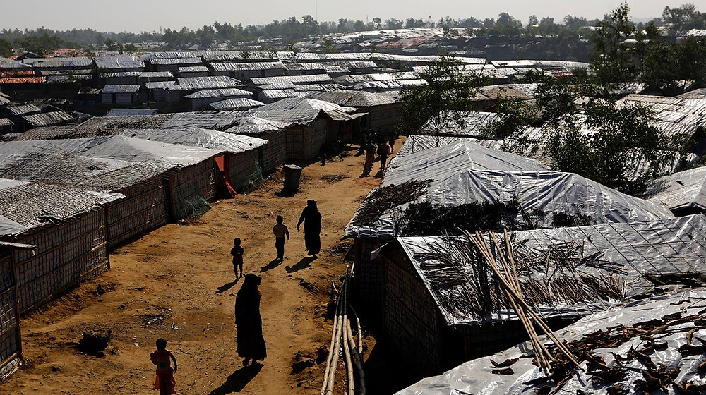 Foreign Minister AH Mahmood Ali on Wednesday, January 10, 2018, hopes there will be a new beginning with Myanmar through Rohingya repatriation. In this Reuters photo taken on January 8, Rohingya refugees walk inside Kutupalong refugee camp near Cox's Bazar of Bangladesh.