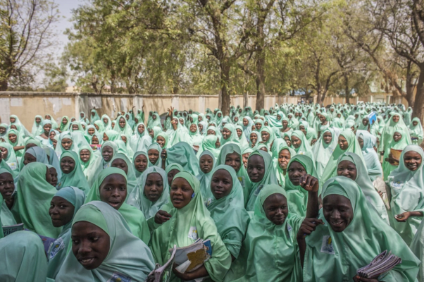 Hundreds of schoolgirls leave the Women's Teachers College Secondary School in Maiduguri, Nigeria. Thousands of girls in the north have been abducted and forced into marriage by Boko Haram. (Jane Hahn/For The Washington Post)