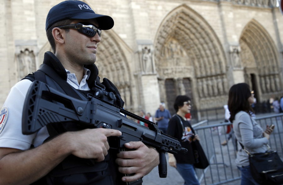 A French police officer stands guard in front of Notre Dame Cathedral in Paris on Sept. 9. (Christophe Ena/Associated Press)