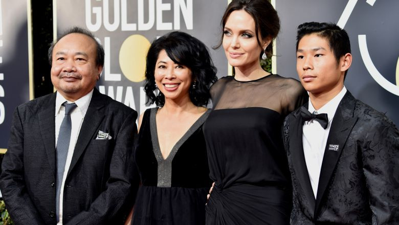 Filmmaker Rithy Panh, activist Loung Ung, actor-director Angelina Jolie and Pax Thien Jolie-Pitt attend the 75th Annual Golden Globe Awards at The Beverly Hilton Hotel on January 7, 2018 in Beverly Hills, California. Frazer Harrison/Getty Images/AFP