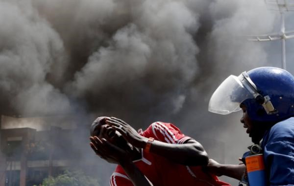 A detained protester cries in front of a burning barricade during a protest in Bujumbura. Picture: REUTERS/Goran Tomasevic