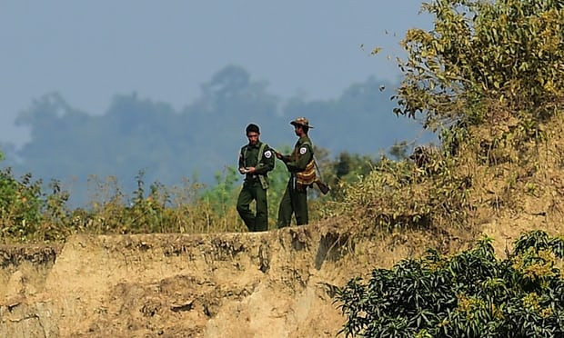 Myanmar soldiers patrol the Bangladesh border, over which 688,000 Rohingya refugees have fled since August. Photograph: Munir Uz Zaman/AFP/Getty Images