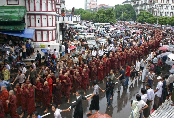 Buddhist monks marching in Yangon during the Saffron Revolution in 2007, another popular uprising suppressed by the military. CreditAgence France-Presse — Getty Images