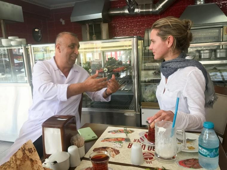 Crisis Group Turkey Project Director Nigar Göksel talking to a Turkish restaurant owner about the impact of unregistered Syrian businesses in Sultangazi district, September 2017.CRISISGROUP