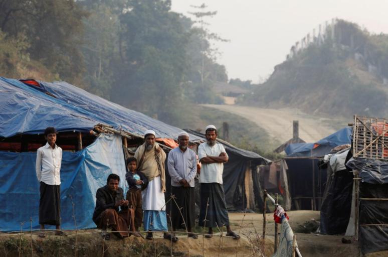 FILE PHOTO - Rohingya refugees are seen in a refugee camp at no-man's land at the Bangladesh-Myanmar border, in Cox's Bazar, Bangladesh January 12, 2018. REUTERS/Tyrone Siu