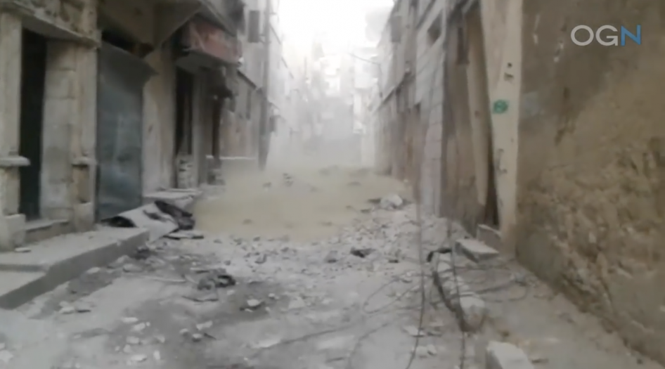 A still from video shows green smoke from a chlorine attack by Syrian government forces in the al-Fardous neighborhood of Aleppo, Syria on December 8, 2016. © 2016 Aleppo Media Center