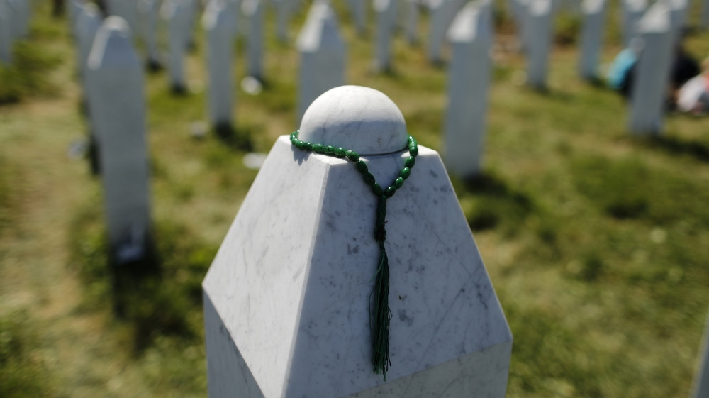 A rosary is placed on a tombstone at the Memorial Center Potocari, near Srebrenica [File: Antonio Bronic/Reuters]