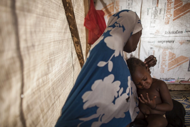 Hamsatu plays with daughter Hauwa at the Dalori displacement camp. She says she was forced to travel on foot and on the backs of motorcycles to the Sambisa Forest, where Boko Haram had set up camps for its sex slaves. (Jane Hahn/For The Washington Post)