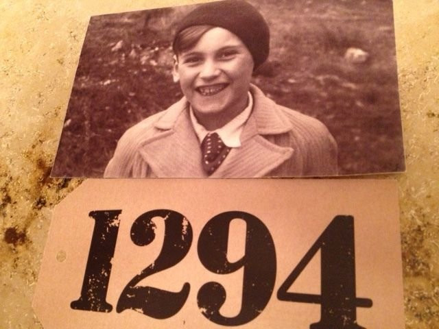 Peter Henry Sprinzels, 12, before leaving Prague on one of Winton's trains, with his allocated number. CreditHelen Sprinzels