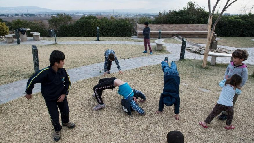In this photo taken Wednesday, Dec. 21, 2016, Yazidi refugee children play in the yard of a hotel in the northern Greek village of Agios Athanasios, near Thessaloniki city. Portugal has offered to take in several hundred of the 2,500 Yazidi refugees living in Greece, arguing that the mistreated religious minority merits special protection. (AP Photo/Giannis Papanikos)  (The Associated Press)