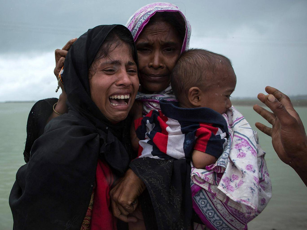 Rohingya Muslim refugees react after being re-united with each other after arriving in Whaikhyang, Bangladesh on a boat from Burma Getty