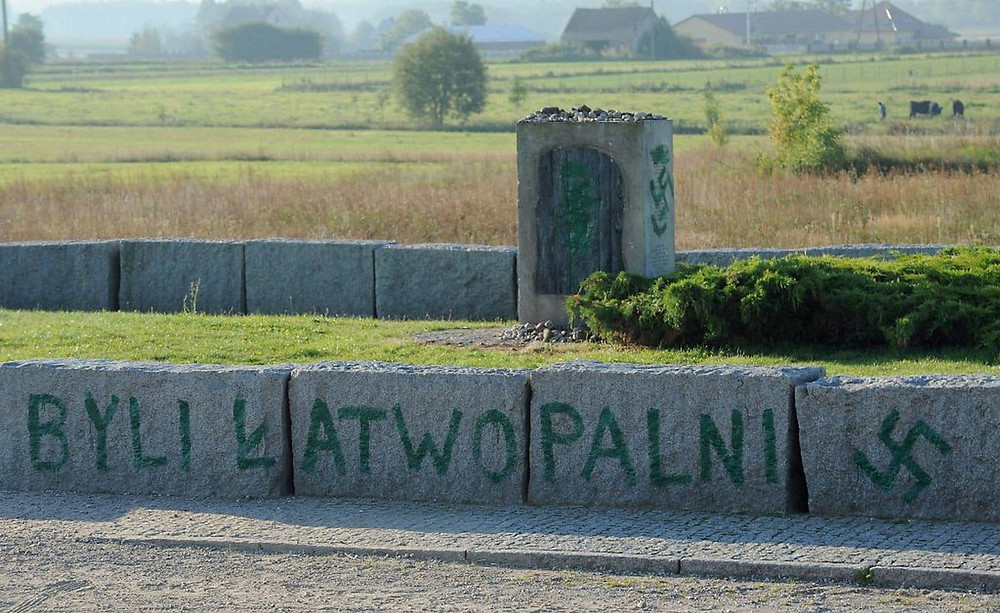 "An inscription reading ""They were Flammable"" and a Nazi swastika are seen in Jedwabne, Poland, Thursday, Sept. 1, 2011, on the monument dedicated to Jews from the town who were burned to death by their Polish neighbors in 1941. (AP Photo/Michal Kosc)"