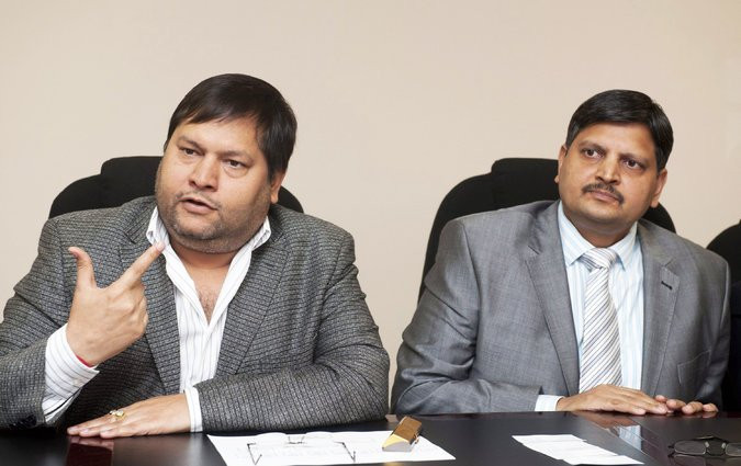 Atul Gupta, left, and Ajay Gupta, two of the three brothers from India who earned fantastic sums leveraging their friendship with Mr. Zuma. Credit Martin Rhodes/Gallo Images