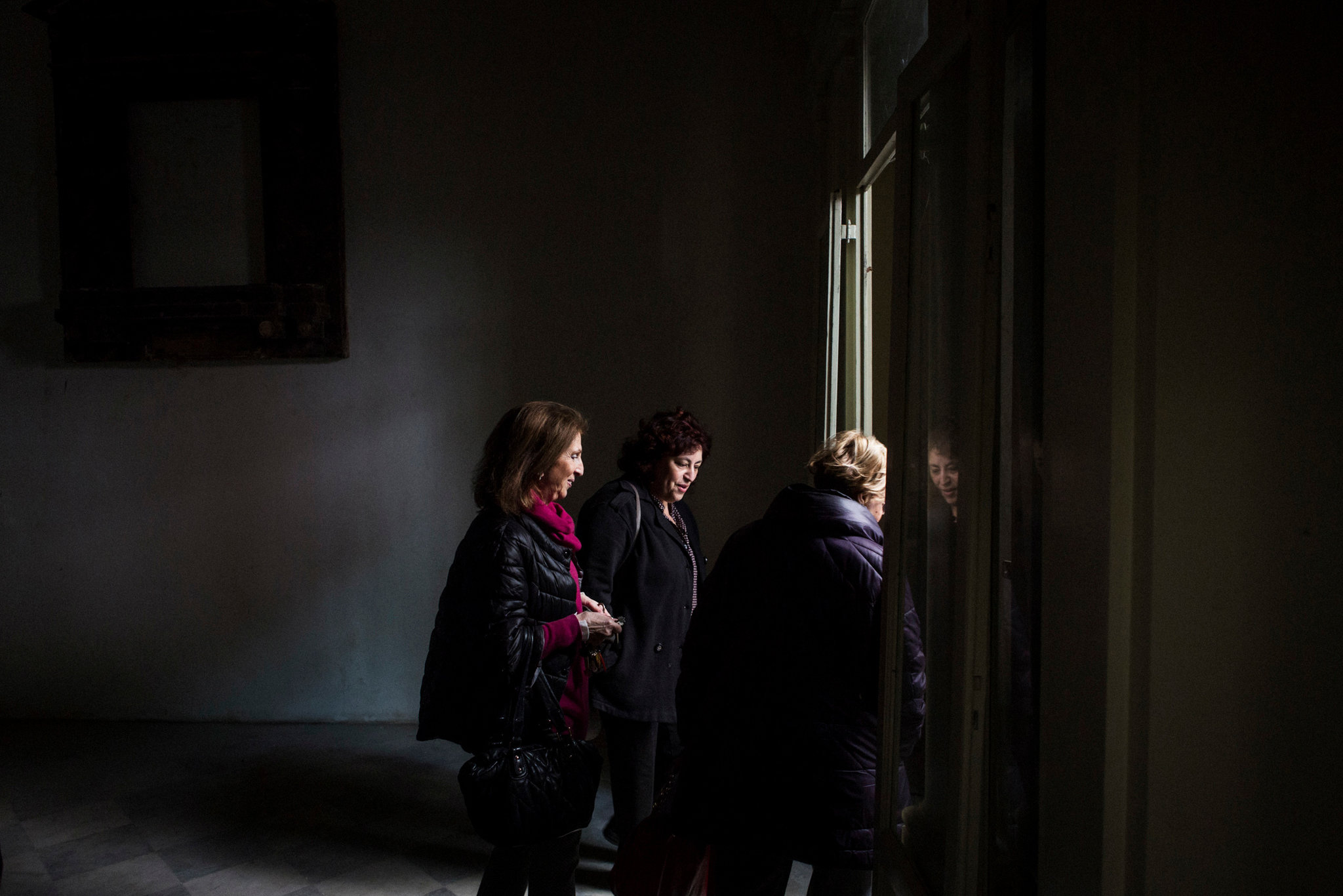 "From left, Evelyne Aouate, Luciana Pepi and Maria Antonietta Ancona — who spearheaded the efforts to get a new synagogue in Palermo — visiting the oratory. ""It's beautiful, but there is still a lot to do,"" Ms. Aouate said. Credit: Gianni Cipriano for The New York Times"