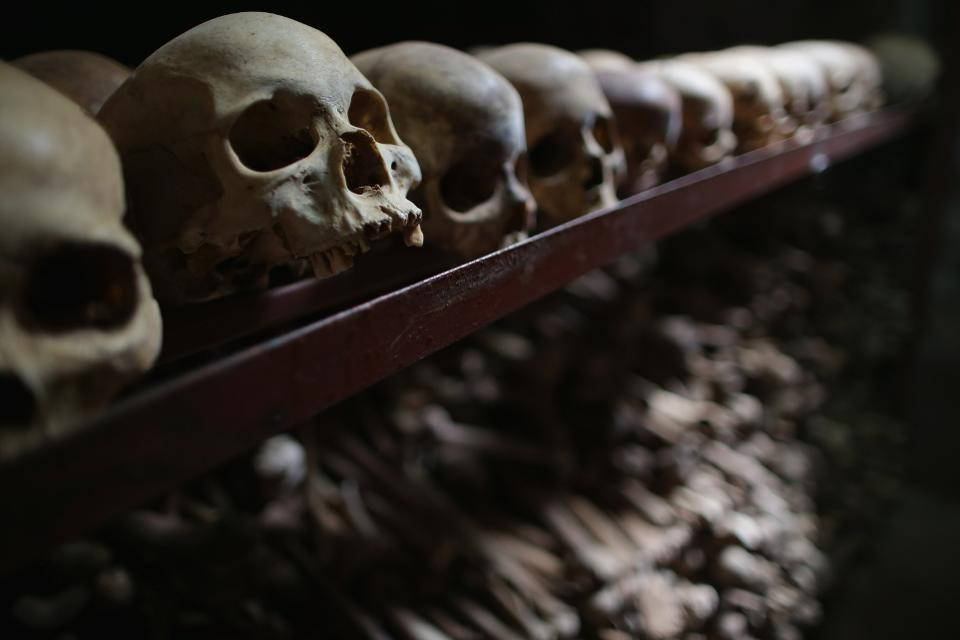 Metal racks hold the bones of thousands of genocide victims inside one of the crypts at the Nyamata Catholic Church memorial. Attackers used guns and grenades to blast their way inside the church on April 13, 1994 where thousands of people had taken refuge, killing men women and children. The memorial's crypts contain the remains of over 45,000 genocide victims, the majority of them Tutsi, including those who were massacred inside the church itself. (Photo credit: Chip Somodevilla/Getty Images)