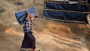 A Rohingya Muslim child carrying a blanket at Kutupalong refugee camp in Ukhiya, Bangladesh, Thursday, Dec. 21, 2017. Many thousands of Rohingya people have crossed over from Myanmar into Bangladesh. (A.M. Ahad/Associated Press
