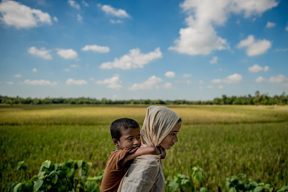 Gulbahar, a 25-year-old Rohingya Muslim, with her youngest daughter after arriving in Bangladesh in November. Credit Tomas Munita for The New York Times
