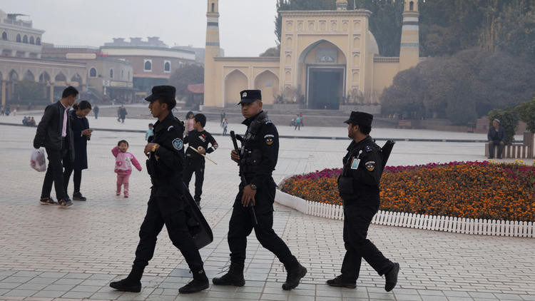 In this Nov. 4, 2017, photo, Uighur security personnel patrol near the Id Kah Mosque in Kashgar in western China's Xinjiang region. (Ng Han Guan / AP)