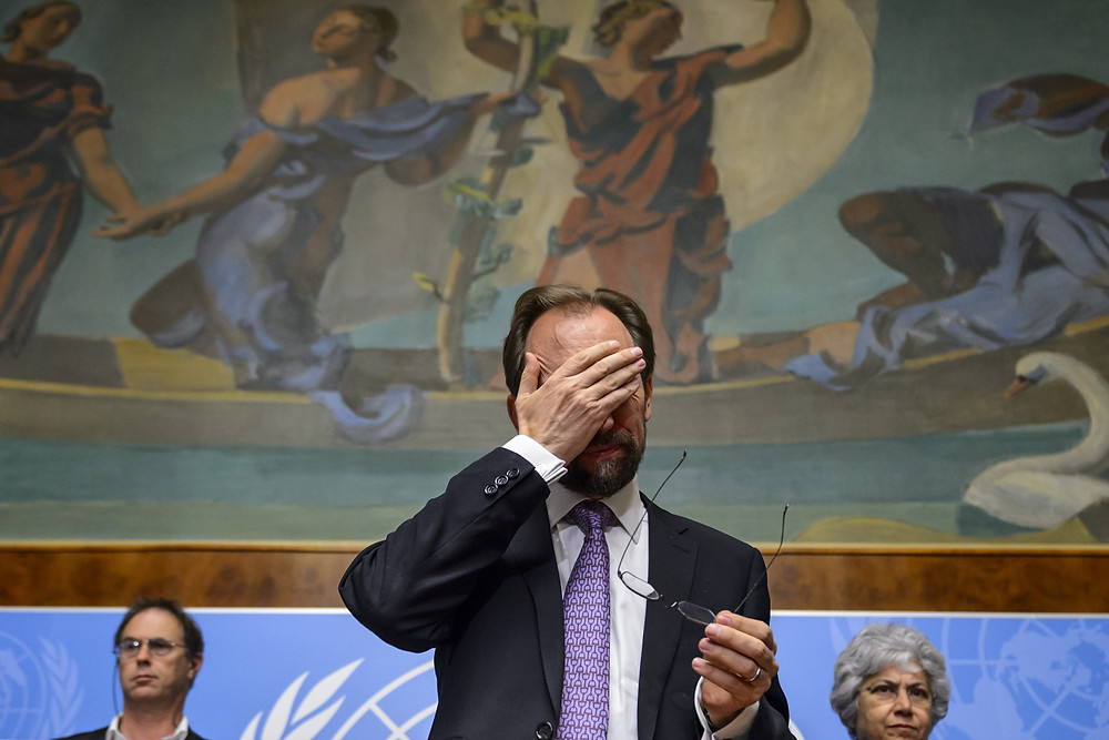 Zeid Ra'ad al-Hussein of Jordan, gestures after a press conference on October 16, 2014 in Geneva. AFP PHOTO / FABRICE COFFRINI (Photo credit should read FABRICE COFFRINI/AFP/Getty Images)
