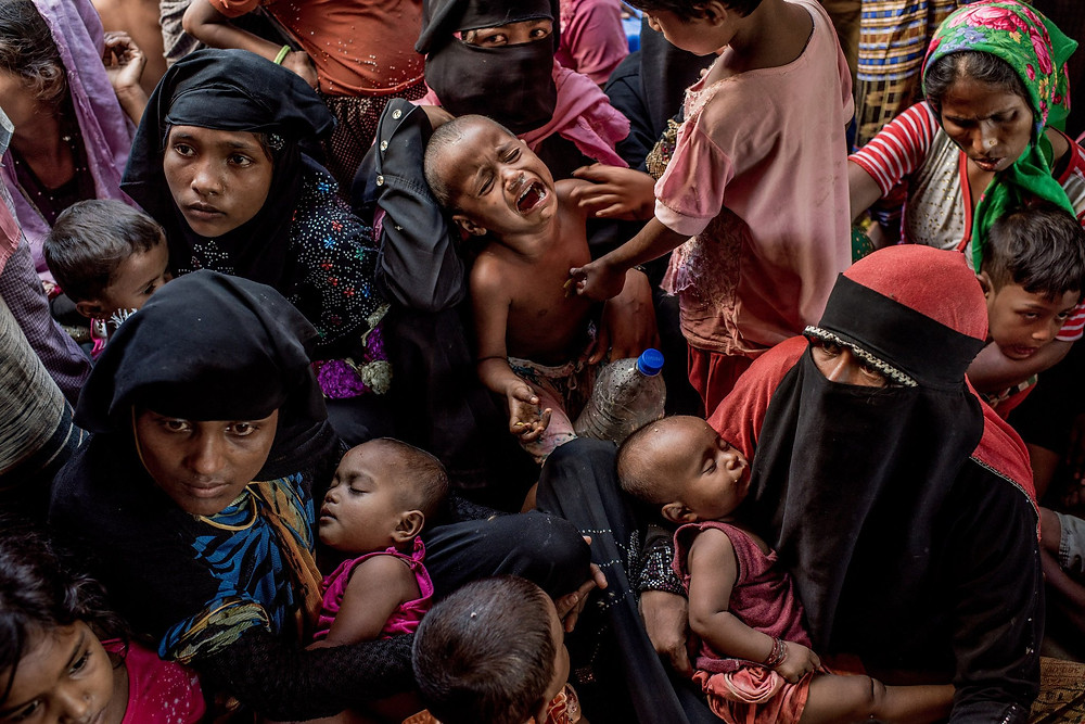Newly arrived Rohingya refugees waiting to be registered in Bangladesh in November. Credit Tomas Munita for The New York Times