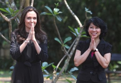 Actress Angelina Jolie (L) and Cambodian-born American human-rights activist and lecturer Loung Ung greet reporters as they arrive for a news conference at hotel in Siem Reap province, Cambodia (February 18, 2017). Image Cred