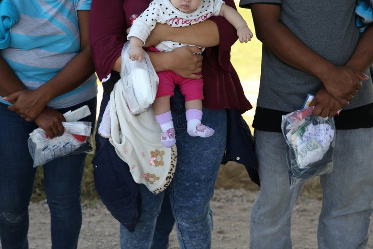 Immigrants after crossing the border near McAllen, Tex., this month. The Trump administration has in the past said it was considering taking children from their parents as a way to deter migrants from coming here. Credit Loren Elliott/Reuters