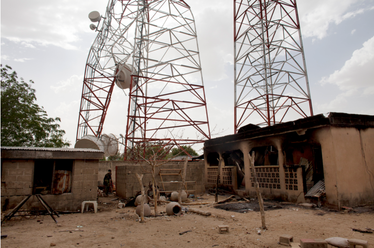 Gwoza's radio tower hangs over like it has been struck down by some natural disaster instead of intense firefights. (Jane Hahn/Jane Hahn for The Washington Post)