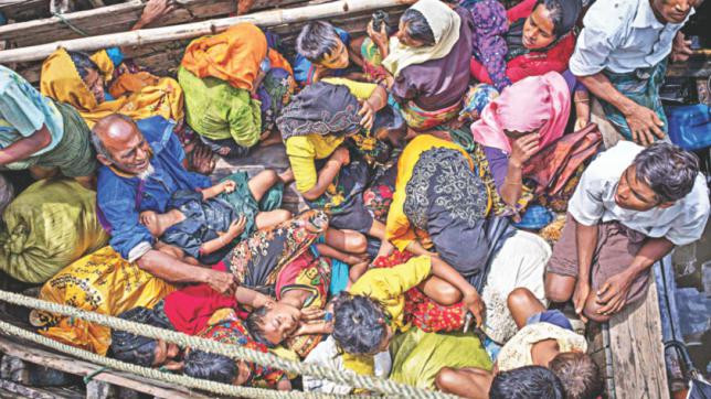 Rohingya refugees arriving by boat in Bangladesh in September last year. PHOTO: AFP