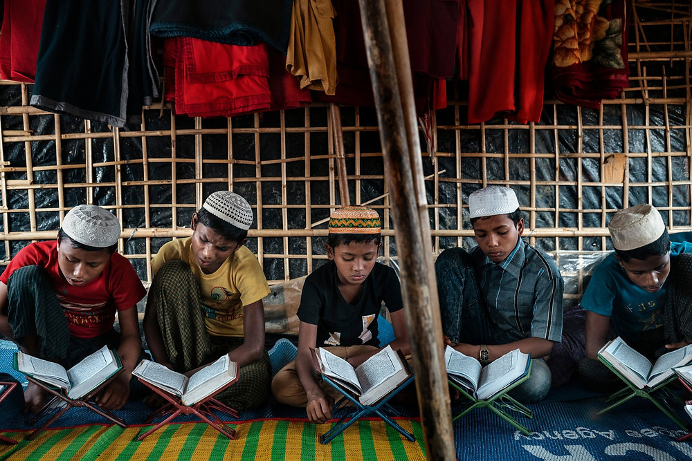 Rohingya boys studying the Quran in a madrasa in Kutapalong camp. CreditAdam Dean for The New York Times