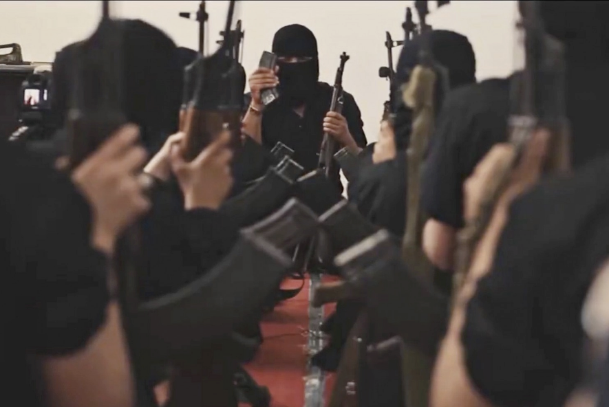 A video of propaganda by the Islamic State is seen online Nov. 18, 2015. It shows children being trained in sports, weapons and Koran recitation in an undisclosed area somewhere between Syria and Iraq. (Balkis Press/Sipa USA via AP)