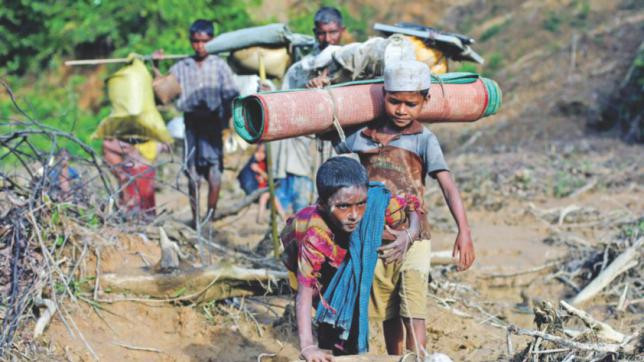 Rohingya refugees walk on a muddy path after crossing the Bangladesh-Myanmar border in Cox's Bazar, September 8, 2017. Reuters file photo