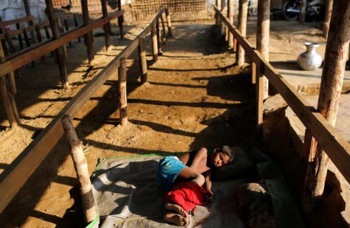 A Rohingya internally displaced person sleeps inside a camp March 15 in Sittwe, Myanmar. (Credit:Soe Zeya Tun, Reuters via CNS.)