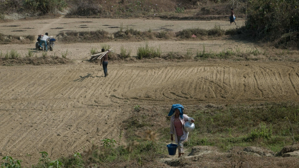 New migrants hope to eventually own land, a prospect previously beyond their reach [Phyo Hein Kyaw/AFP]