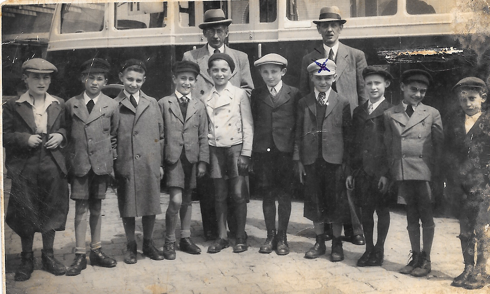 Ernst Steiner, fourth from the right, in Bratislava in 1939, shortly before his train journey to England. CreditAmit Yahav