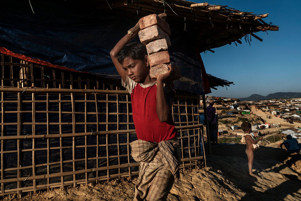 A Rohingya child in the Kutapalong camp. Thousands of households in the Rohingya camps are headed by children who arrived unaccompanied by any adult family member.CreditAdam Dean for The New York Times