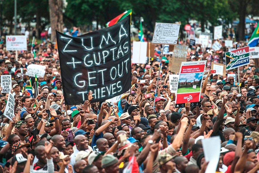 President Jacob Zuma has been swept up by investigations into the Gupta brothers amid an outcry that he let them hijack the government. A march last April in Pretoria. Credit Mujahid Safodien/Agence France-Presse — Getty Images