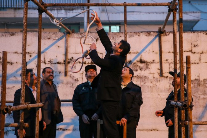 Officials in Iran preparing a noose for an execution in 2014. Amnesty International said in its annual report that almost 90 percent of the executions that it recorded last year were carried out in Iran, Pakistan and Saudi Arabia. CreditArash Khamooshi/Agence France-Presse — Getty Images