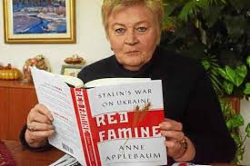 """Vera Andrushkiw, president of the Detroit Regional Council of the Ukrainian National Women's League of America, reads """"Red Famine Stalin's War on Ukraine"""" by Anne Applebaum at her Troy home. JAMESON COOK--THE MACOMB DAILY"""