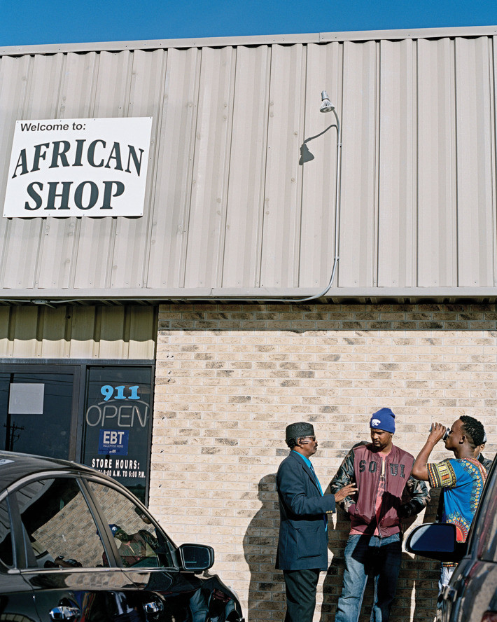 Somali refugees outside the ­African Shop in Garden City. Photo: Benjamin Rasmussen