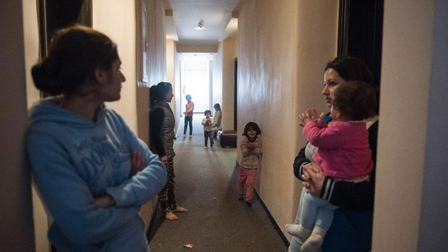 In this photo taken Wednesday, Dec. 21, 2016, Yazidi refugees are pictured at the corridor of a hotel, in the northern Greek village of Agios Athanasios, near Thessaloniki city. Portugal has offered to take in several hundred of the 2,500 Yazidi refugees living in Greece, arguing that the mistreated religious minority merits special protection. (AP Photo/Giannis Papanikos)  (The Associated Press)