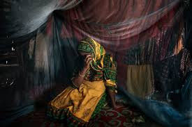 """Rahima Khatun, 21, grew up in a refugee camp, part of an earlier wave of Rohingya who escaped to Bangladesh. To survive as a single mother after her husband left her, she works as a prostitute. """"I'm doing all this for my son,"""" Ms. Khatun said. """"I am lucky because he is not a girl."""" Credit Adam Dean for The New York Times"""