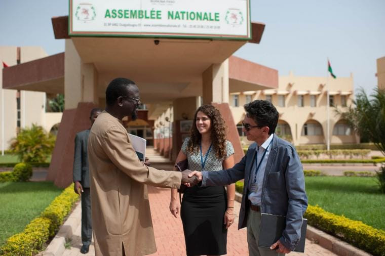 Cynthya Ohayon and Rinaldo Depagne with Maitre Sankara, National Assembly's acting president. Ouagadougou, on 13 October 2017. CRISISGROUP/ Julie David de Lossy
