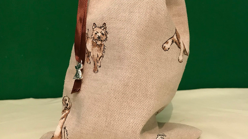 Hessian style material with playful dogs design