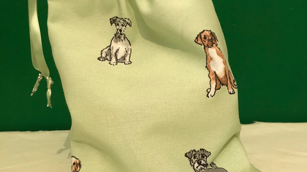 Pale green with dogs sitting, standing and playing