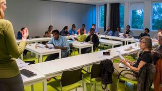 presentation Wij Zijn Hier en Amsterdam