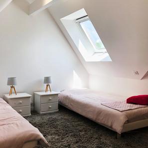 Chambre sous pente de toit
