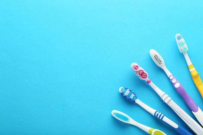 Toothbrushes on blue background.jpg